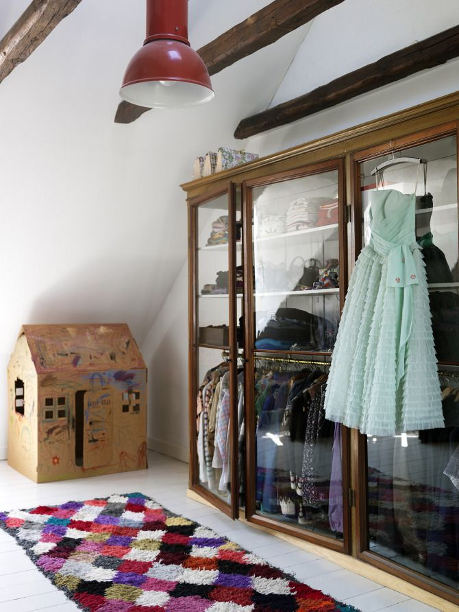 Another display cabinet repurposed for stylish clothing storage at home; photo by Petra Bindel #dressing_room #wardrobe