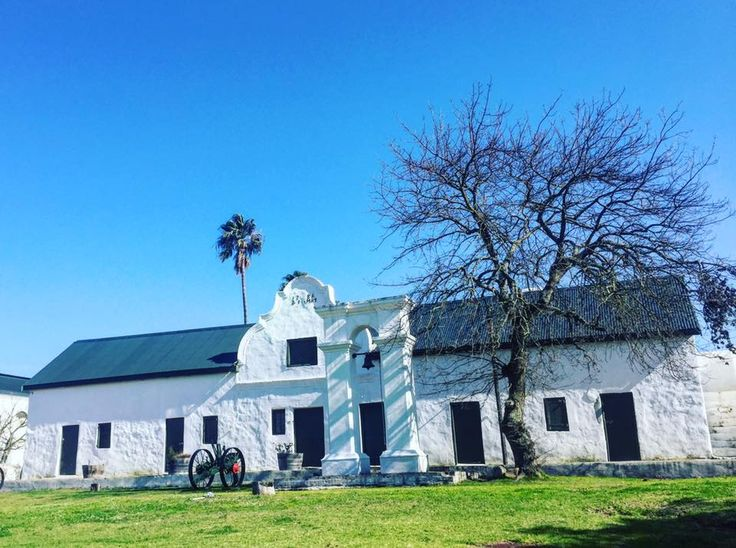 Heritage oozes from the walls here at Hazendal Wine Estate, with a history that dates back to 1699.  Here the old slave bell can be seen in front of the original Homestead dated 1781.