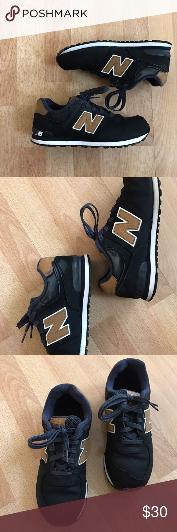 574 New Balances Black new balances with hints of tan and blue. Photos show areas of wear. Will gladly show more photos of the condition of the shoe upon request! Shoe is pre-loved but is still in great condition. Size 5.5 in kids but fits like a 7 in women's! Make me an offer! :) New Balance Shoes Sneakers