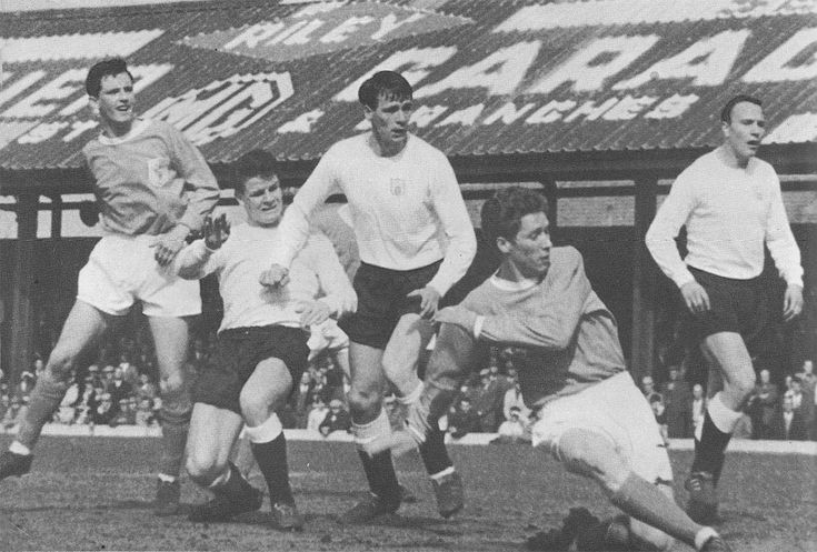 21st August 1965. Blackpool forward Alan Ball holds off Fulham duo Stan Brown and Bobby Robson to get a shot at goal, at Bloomfield Road.