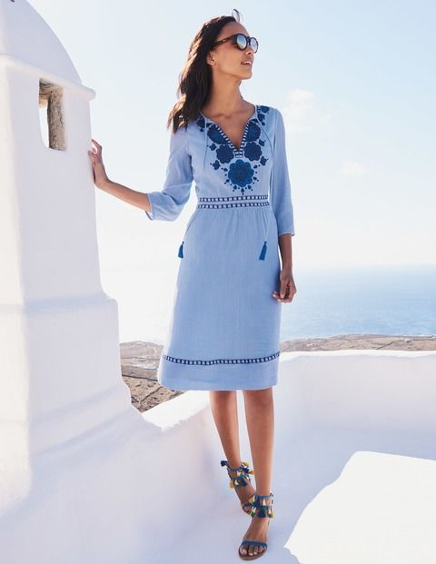 Get in touch with your boho side in this 100% cotton dress. The fixed waistband nips you in to create a flattering shape, while the floral embroidery and tasselled cords add a special touch. Pair with wedges for evening dressing, or keep things casual with laid-back flats.