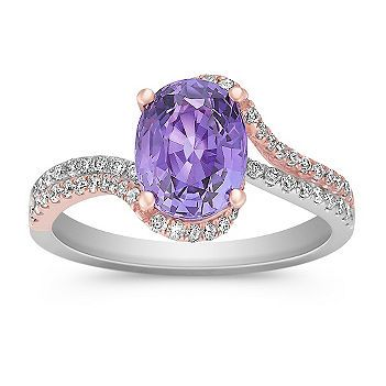 Oval Lavender Sapphire and Round Diamond Ring in Rose and White Gold  This gorgeous ring is part of our exclusive One-Of-A-Kind collection.  One vibrant oval lavender sapphire, at 2.60 carats TW, is beautifully surrounded by 72 round diamonds, at .42 carat TW.  These sparkling gems are crafted in quality 14 karat white and rose gold in a swirl design.  The total gem weight is 3.02 carats.