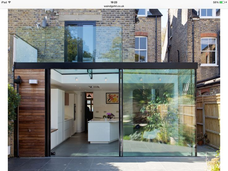 Wood cladding, floor to ceiling glass extension