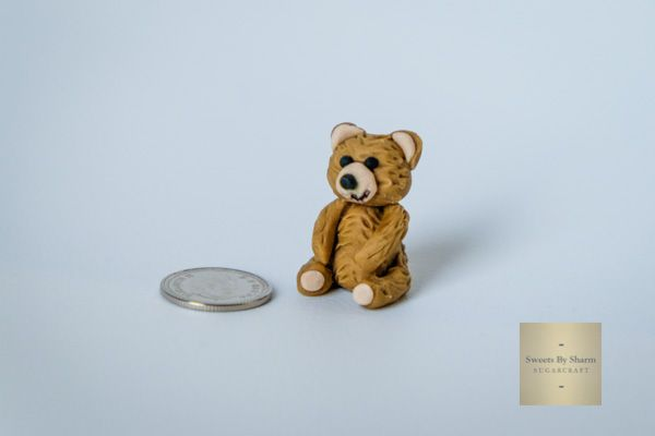 A Tiny Teddy Bear by #SweetsBySharm (dime for comparison). SweetsBySharm.com