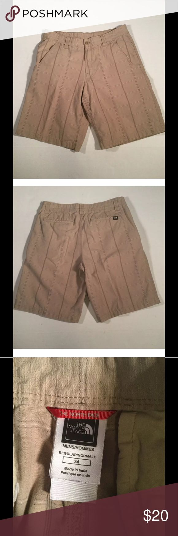 """The North Face Men's Dress Shorts Size 34 Nice men's shorts with normal wear and no observed flaws or defects. Has belt loops, two front pockets and two hip pockets. Beige with a window pane design. Tag size 34.   waist: 16.5""""  inseam: 11""""  leg opening: 13""""  total length: 22 1/4"""" The North Face Shorts Flat Front"""