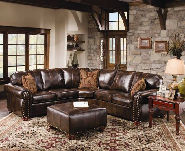 Rustic leather sectional sofa with tables and carpets ...