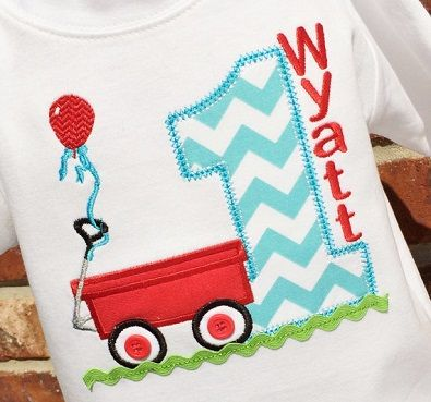 Little Red Wagon sits atop lime green ric rac with a balloon floating above. Appliqued age alongside. Wagon wheels feature little red button centers. Purchase this from my store on Etsy.com/lilshabebe!