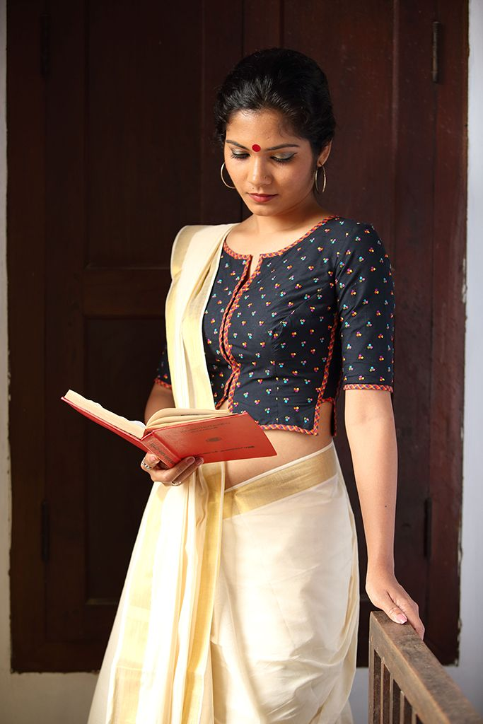 The Agnisakshi Blouse – This blouse is our take on the iconic shirt blouse worn by fiery women writers and freedom fighters of Kerala. Classic and elegant like the women who wore them. The tiny coloured embroidery motifs on the soot black blouse add to its simple allure. | Seamstress