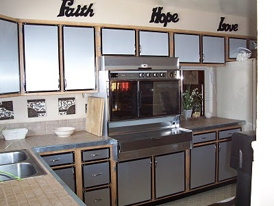 another shot eclectic kitchen we cabinets covered aluminum contact paper added black trim silver how to removing from for ki