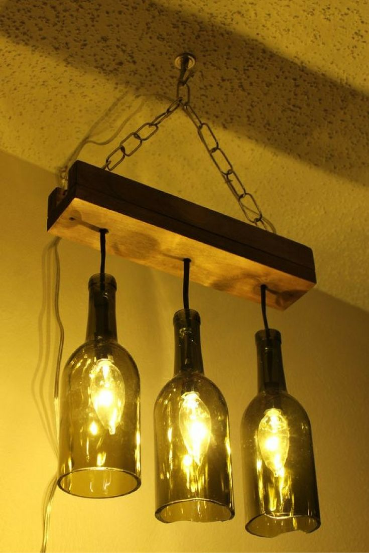 Если вы ищите оригинальный и стильный светильник, то люстра из бутылок обязательно должна вас заинтересовать. Люстра из серии BOTL состоит из деревянной планки и плафонов из винных бутылок. Цвет бутылок оливковый. В комплекте поставляется необходимая фурнитура для крепления светильника к потолку. Так же светильник комплектуется лампой накаливания 40-60 Вт. Возможен выбор длины и цвета провода. Цена от 100$ (3 плафона). По вопросам заказа пишите Viber, WatsApp +380988507548 Telegram…