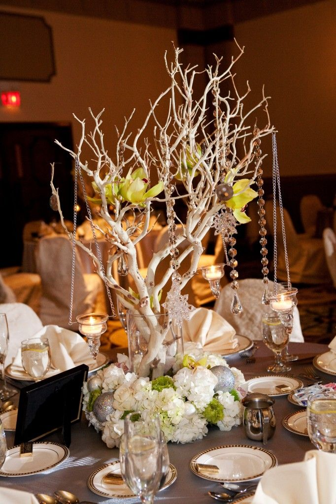 Manzanita Trees With Orchids Crystals And Hanging Votives Are Taken To The Next Level Tree Wedding CenterpiecesCenterpiece IdeasWedding TablesWedding