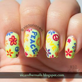 Hippie nail art.  Peace sign.  Flowers.  Colorful.