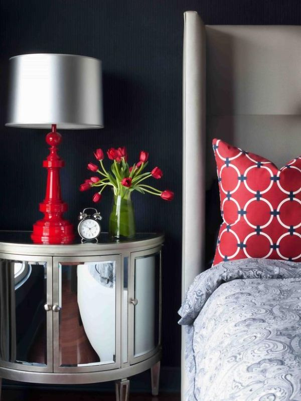 Gray bedroom with red accents...love mirrored nightstand, love the red accent color.
