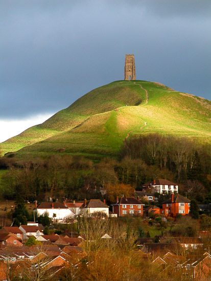 The 15th century tower of St Michael's Church overlooking Glastonbury Tor, Somerset, England