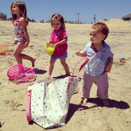 HOW TO GET THIS PICTURE: Lay down in a spot where your kids will be a little uphill from you. Somehow convince them to walk closely together and shoot away! Get more kids beach photo opp ideas here >>