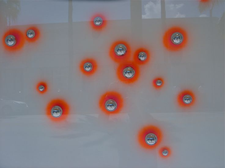 SuperPOX installation. With neon Orange and Pink background. ArtCenter South Florida display window, LMNOQ: Display Window