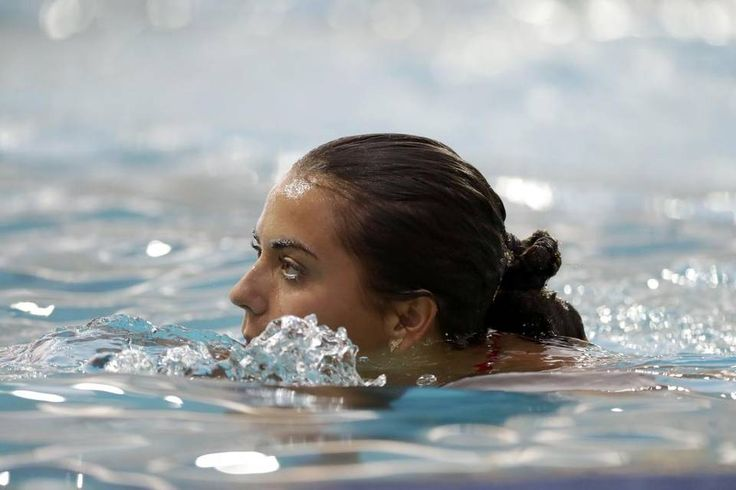United States' Kassidy Cook emerges from the water as she takes part in a training session in the Maria Lenk Aquatic Center at the 2016 Summer…