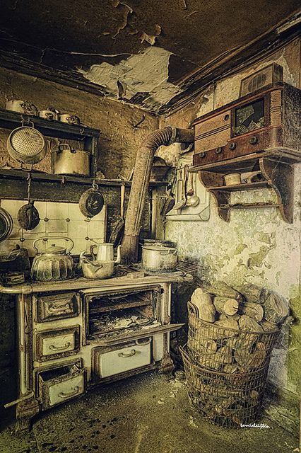 Forgotten kitchen. The homeowners left everything, even pots and pans behind, as if they believed they'd come back later and retrieve them. The wood for the wood-fired stove was already chopped and ready. The radio is awesome and they left that too.