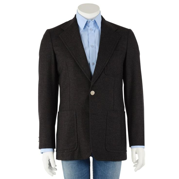 A patch pocket style sports coat from Louis Vuitton. Featuring charcoal wool & cashmere blend flannel in a two button single breasted cut. Silver buttons give the jacket a smart edge. Lined in signature LV ...