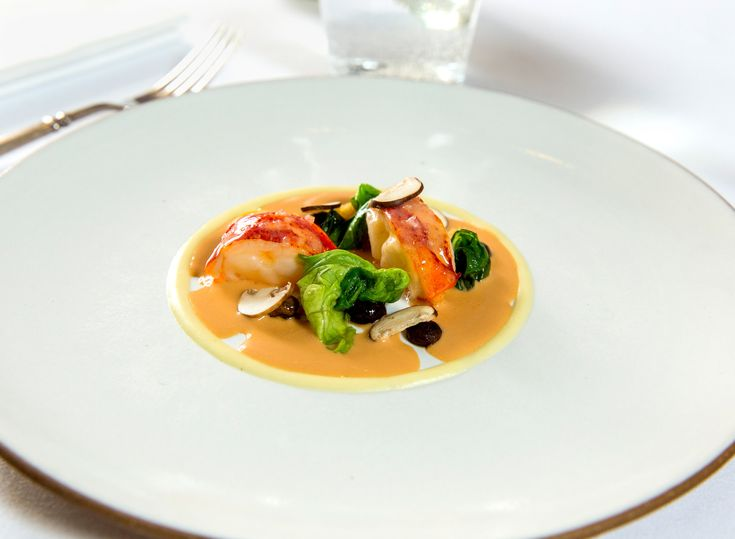 Lobster Newburg with baby button mushrooms and bibb lettuce Restaurant Review: Eleven Madison Park in Midtown South - NYTimes.com