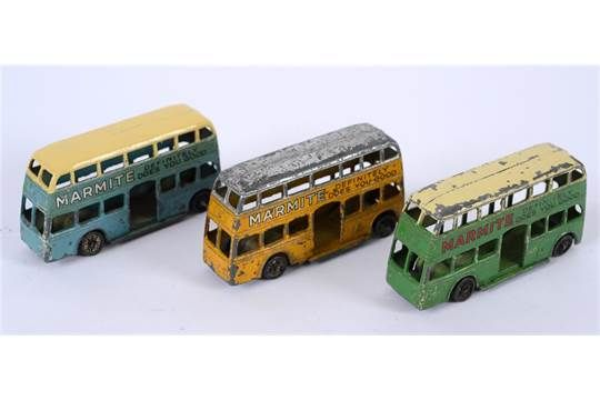 THREE PRE-WAR DINKY BUSES comprising a Dinky No.29a, Motor Bus, yellow with a silver roof