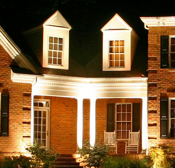 We used up lighting on this home to accentuate the width and depth of the home and bring out special features such as the columns.
