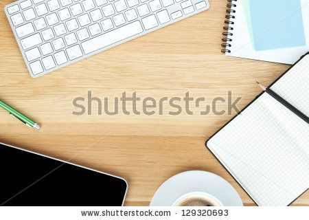 Office supplies, gadgets and coffee cup on wooden table - stock photo