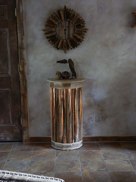 """Etsy. """"This side-table is crafted from rough sawn boards & hand selected """"Saguaro Ribs"""" (twigs/branches) harvested directly from the southwestern Sonoran Desert. Also included is an upper-center mounted Candelabra - UL rated light fixture with in-line light switch & bulb. Table measurements are 37"""" High, 20 1/2"""" Wide & 13"""" Deep."""""""
