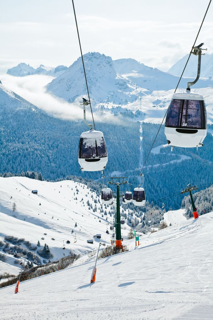 Snow action: monocable gondola lift at Val Di Fassa ski resort in Italy