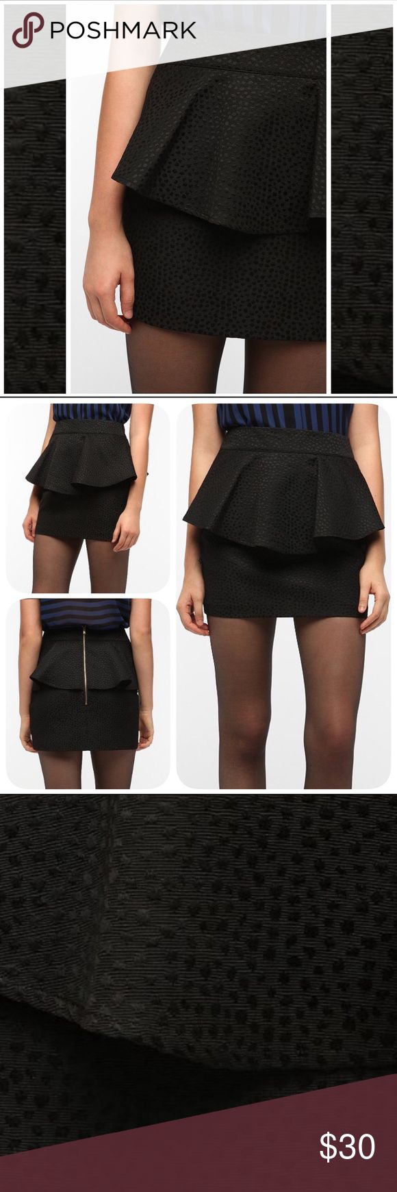 Urban Outfitters Peplum Skirt HP BOGO Textured, jacquard mini peplum skirt from silence & noise for Urban Outfitters. Cut in a tulip silhouette; exposed zip at the back. Topped with a ruffled peplum at the waist. Allover jacquard dot texturing. Fully lined. Size 10. New with tags and in perfect condition. Urban Outfitters Skirts