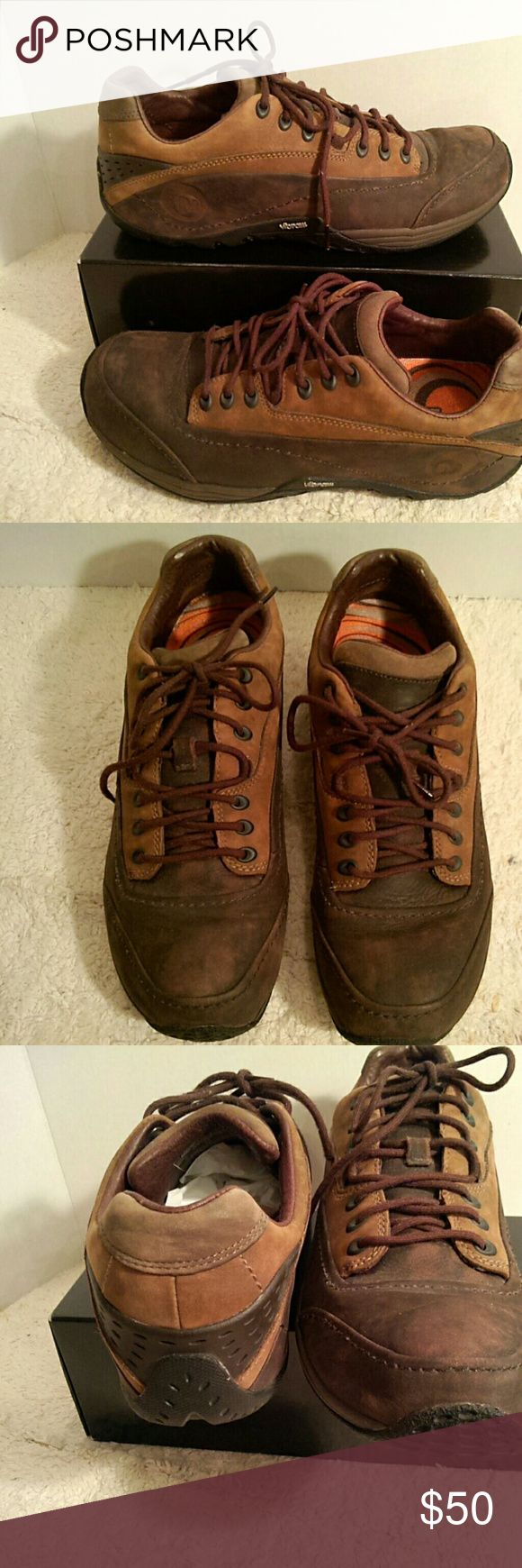 Mens Merrell brown leather sneakers two tone brown leather - mottled dark brown and a lighter tan; dark brown is mottled - inconsistent color; Vibram; air cushion insoles; Merrell Continuum; mens size 9 = womens 10.5   GUC    (T-26) Merrell Shoes Sneakers