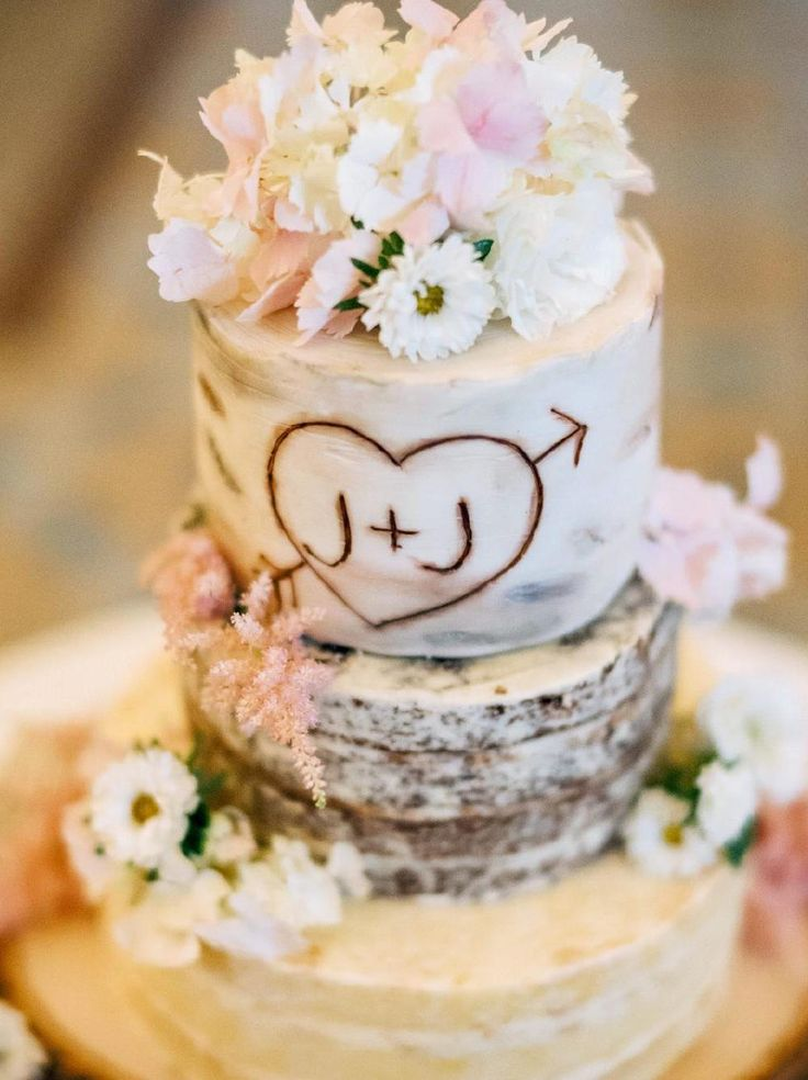 "Utterly romantic rustic tree trunk wedding cake with the bride and groom's initials ""carved"" in the side 