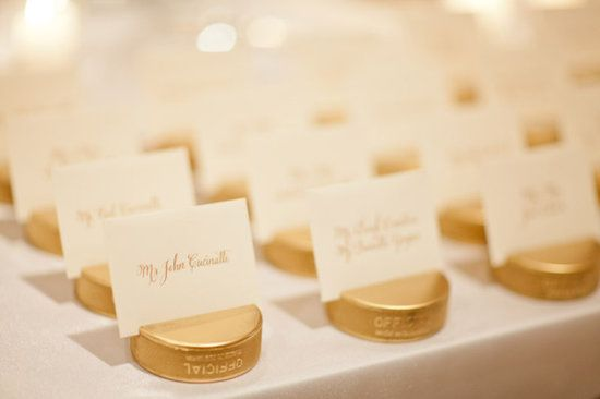 Hockey Wedding Ideas: Gold Puck Escort Cards @Meghan Rogers (this is a little extravagant, but a totally cute idea!)