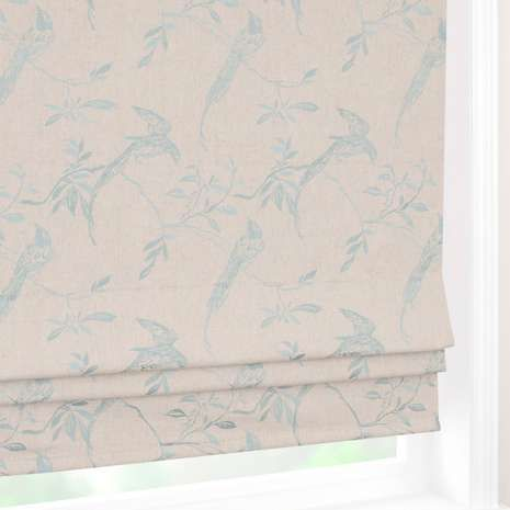 Crafted from a linen blend with an effective blackout lining, this roman blind is decorated with a duck-egg blue bird pattern on a natural backing.