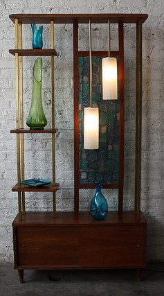 Room dividing shelf lamp storage with stained glass panel.
