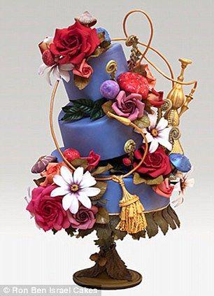 Blue pedestal cake with gold tassels, massive sugarpaste flowers.    Ron Ben Israel Cakes