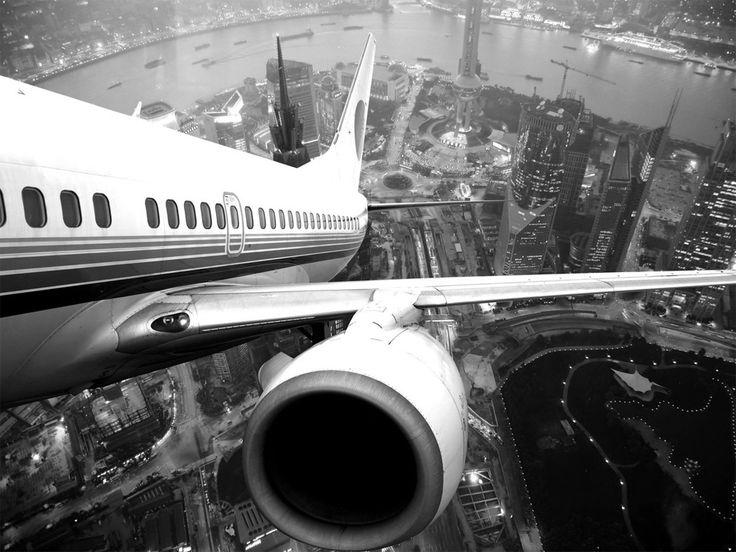 airplane take off over shanghai, china