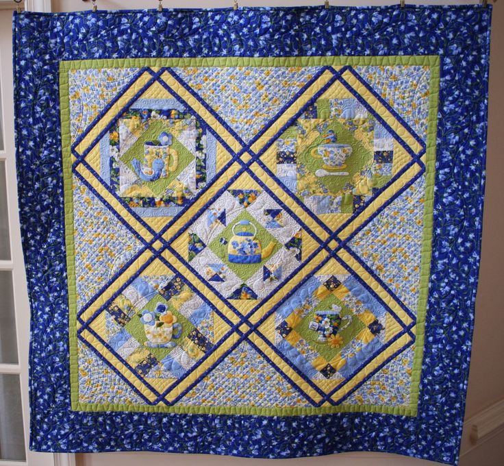Completed Cozy Afternoon at the Cottage. The quilt was hand appliqued and machine quilted using my Pfaff 4.0 Quilt Expression. I used a Westalee ruler foot and long arm rulers for the cross-hatching.