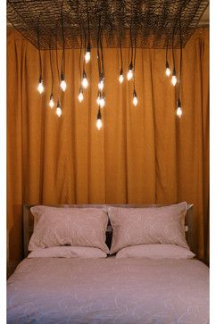 Old box springs with lights as a chandelier