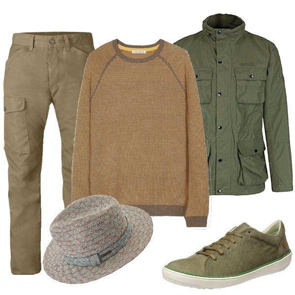 Outfit composto da pantaloni verdi con tasconi, maglioncino beige, giubbotto verde, scarpe basse verdi e cappello che riprende i colori dei capi che compongono il resto dell'outfit.