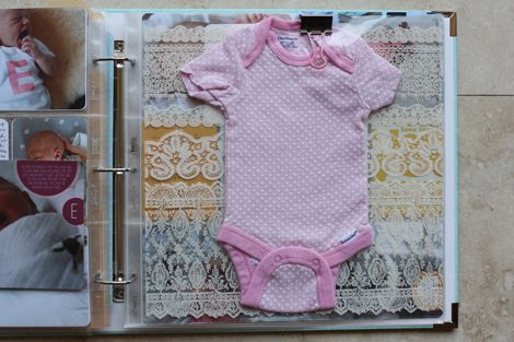 Onesie and transparency tucked inside page protector and clipped with binder clip and journaling card