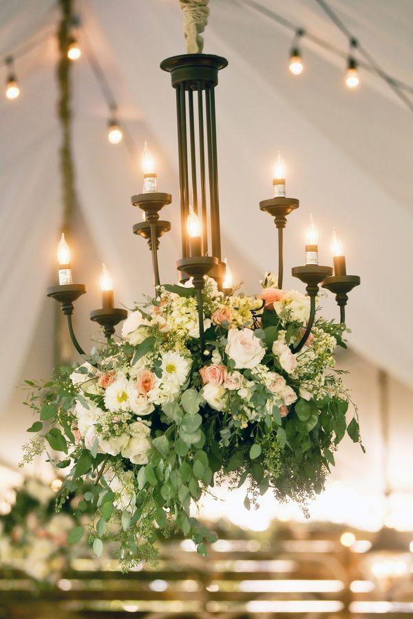 floral arrangement hanging from a chandelier, photo by Pepper Nix Photography http://ruffledblog.com/backyard-chic-utah-wedding #flowers #weddingideas #reception