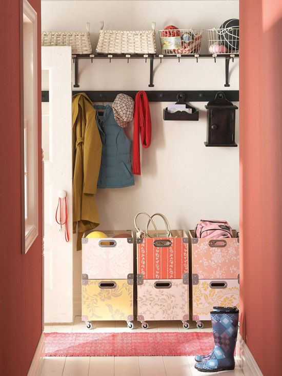 One for Each  Busy families will appreciate this mudroom design with one section of stackable crates for each child. Shelves up top allow storage space for items that are rarely used. Pegs offer the perfect places to hang jackets, shopping totes, and purses.