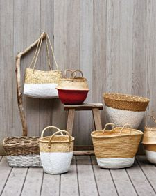 Dip-Dyed Baskets  When dipped in paint, rustic baskets become thoroughly modern carryalls that look as if they came straight out of a design shop.
