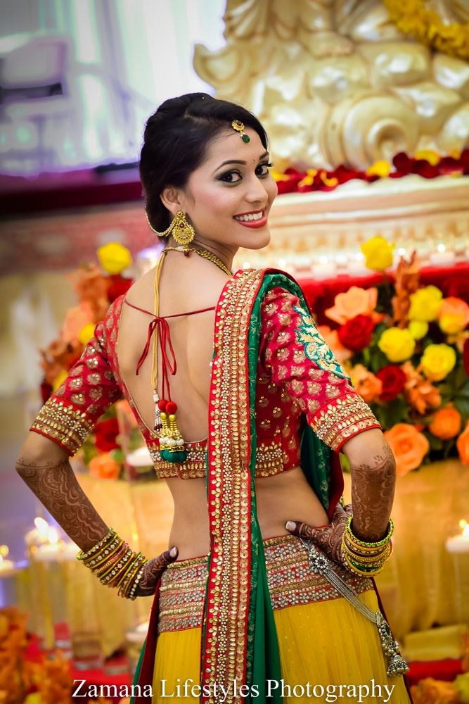 Indian bride wearing bridal lehenga and jewelry. #IndianBridalHairstyle #IndianBridalMakeup Bhumi and Nikhil | Macon, GA Indian Wedding by Zamana Photo