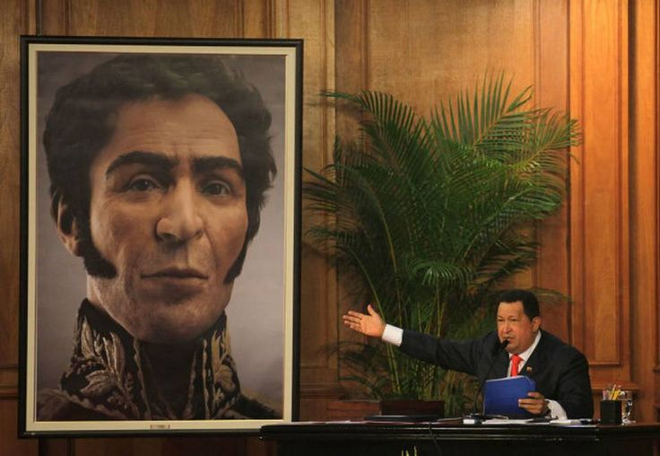 Venezuela's President Hugo Chavez unveils a photograph-like portrait of Venezuela's independence hero Simon Bolivar on the 229th anniversary of Bolivar's birth at Miraflores presidential palace in Caracas, Venezuela, Tuesday, July 24, 2012. A team of researchers produced the image based on studies of Bolivar's remains.