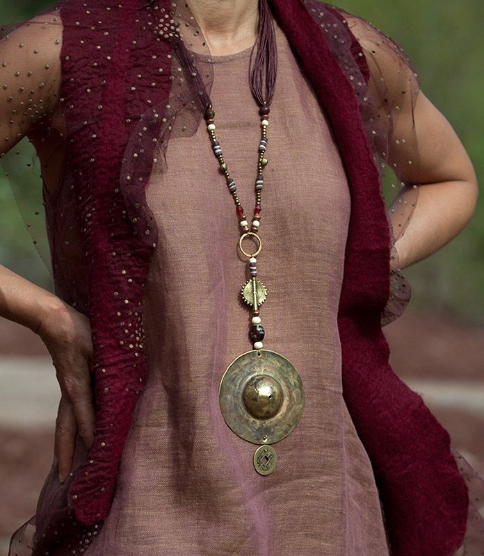 hammered brass pendant with ethnic beads  AMALTHEE CREATIONS