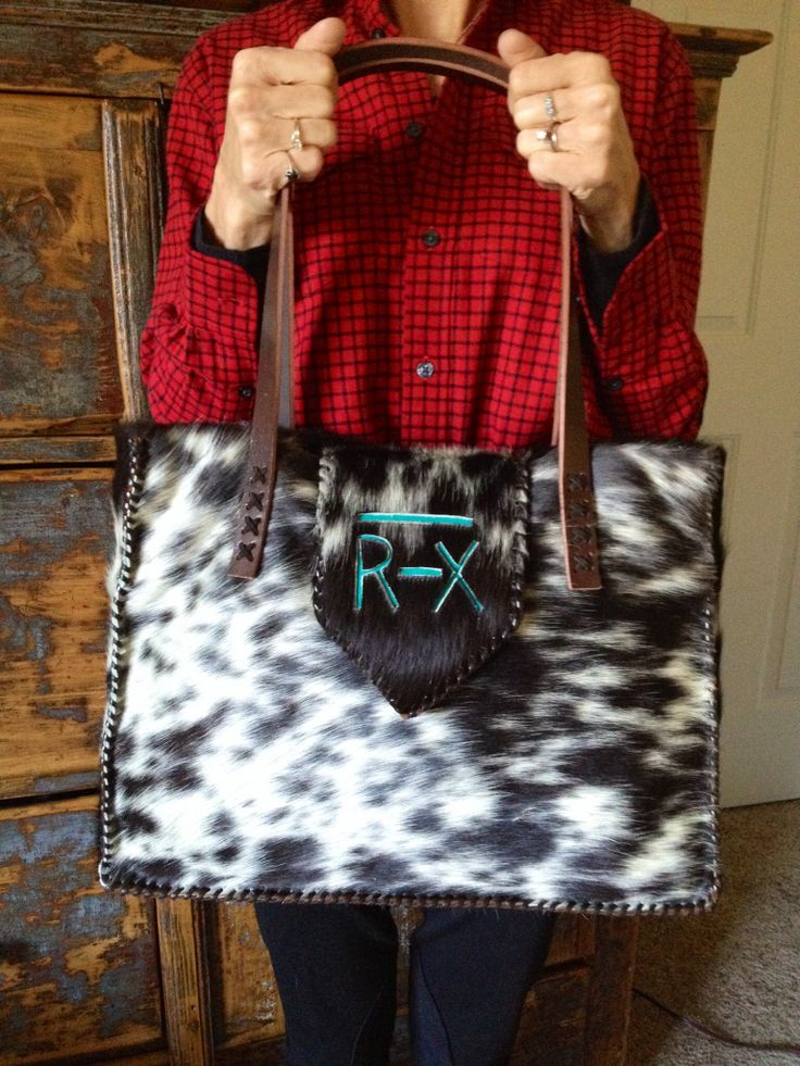 Custom cowhide bags from gowestdesigns.us. This bag features the customers family brand in turquoise suede.