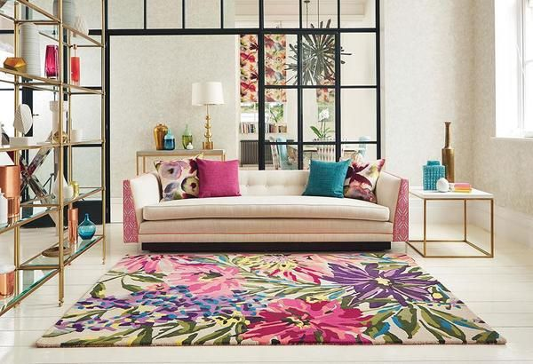 The Harlequin Floreale Fuschsia 44905 Designer Modern Floral Wool Rug is a beautiful modern designer wool rug from Harlequin featuring a stunning burst of colour with floral elements throughout: