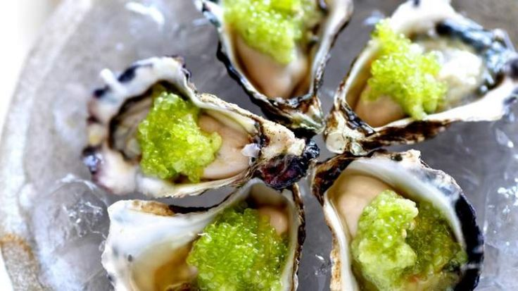 Oysters with cucumber and finger limes